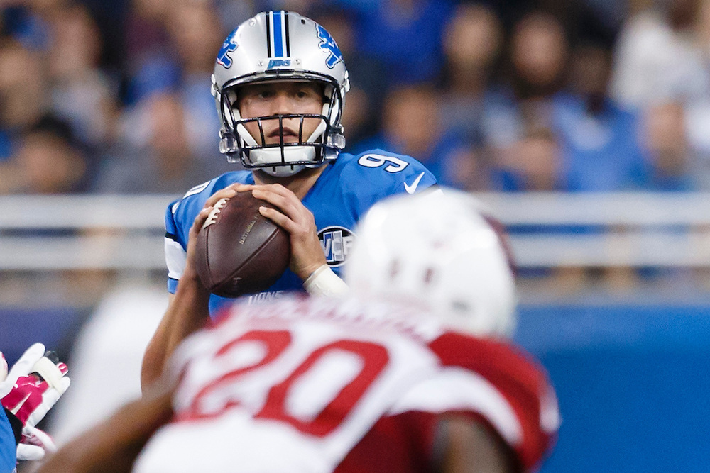 Detroit Lions quarterback Matthew Stafford (9) looks to pass against the Arizona Cardinals during an NFL football game at Ford Field in Detroit, Sunday, Oct. 11, 2015. (AP Photo/Rick Osentoski)