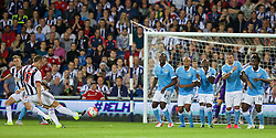 WEST BROMWICH, ENGLAND - Monday, August 10, 2015: Manchester City players defend a free kick from West Bromwich Albion's Rickie Lambert during the Premier League match at the Hawthorns. (Pic by David Rawcliffe/Propaganda)