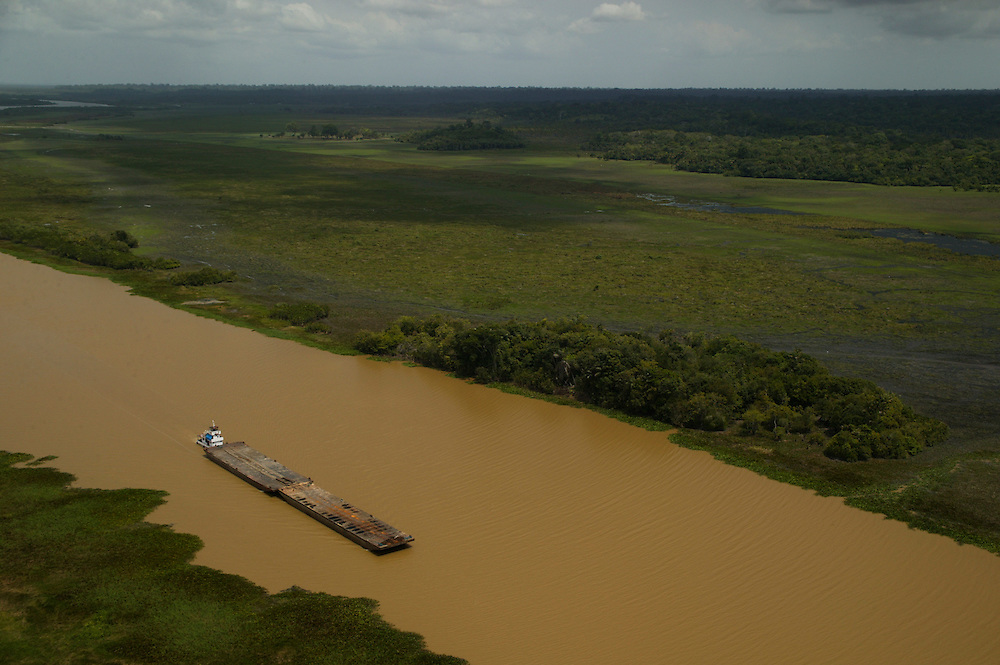 An empty barge moves down the Jaurucu River near Porto de Moz in Para State, Brazil.