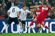 (R) Poland's Robert Lewandowski fights for the ball with (L) Phil Jagielka and Leighton Baines during the 2014 World Cup Qualifying Group H football match between England and Poland at Wembley Stadium in London on October 15, 2013.<br /> <br /> Great Britain, London, October 15, 2013<br /> <br /> Picture also available in RAW (NEF) or TIFF format on special request.<br /> <br /> For editorial use only. Any commercial or promotional use requires permission.<br /> <br /> Mandatory credit:<br /> Photo by &copy; Adam Nurkiewicz / Mediasport