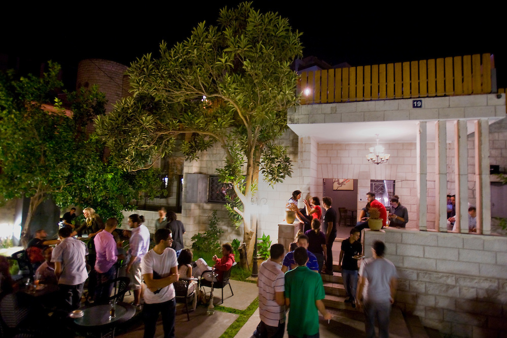 Palestinians enjoy ramallah nightlife at the Beit Hanisse bar in Ramallah..Credit photo: Olivier Fitoussi.