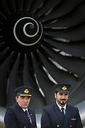 Qatar Airways pilots and fan blades of an Airbus A350-1000 at the Farnborough Airshow, on 18th July 2018, in Farnborough, England.