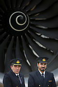 Qatar Airways pilots and fan blades of an Airbus A350-1000 at the Farnborough Airshow, on 18th July 2018, in Farnborough, England.