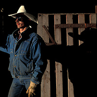 Canada,  Saskatchewan, (MR) Darwin Deuck stands outside horse stable during farm auction in Whitewood