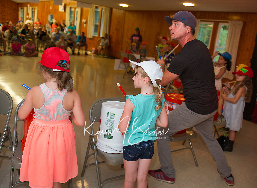 """Mr. Rich leads children from Lakes Region Child Care Services in their presentation of """"Youth Beatz"""" at the Leavitt Park Clubhouse on Tuesday evening.   (Karen Bobotas/for the Laconia Daily Sun)"""