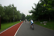 Time Trail Course, KM 8-11, the course winds through a wooded park and then back to the Bird's Nest finish - Journalists and delegates pre-ride the 2011 Tour of Beijing Scouting Photos