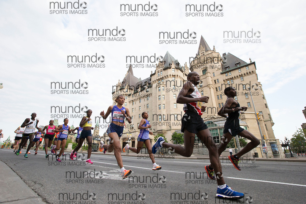 (Ottawa, Canada---24 May 2015) The start of the women's race running past the Chateau Laurier at the start of the marathon during the Tamarack Run Ottawa Race Weekend.
