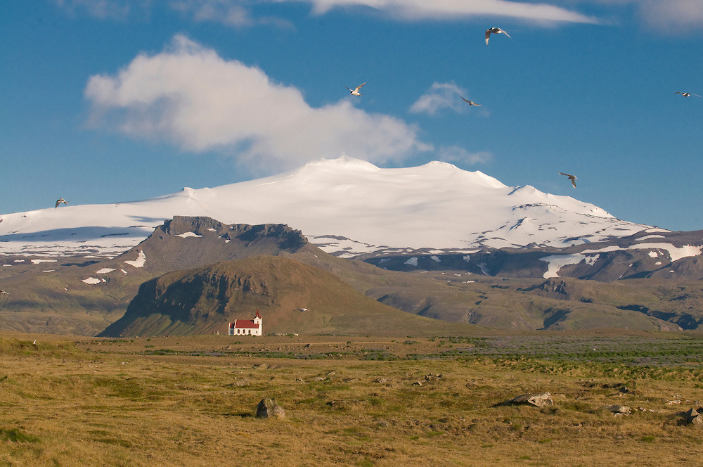 Mountainlandscape with body of water and Kirche. Snaefellsjökull. Iceland.