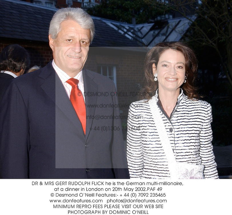DR & MRS GERT RUDOLPH FLICK he is the German multi-millionaire, at a dinner in London on 20th May 2002.	PAF 49