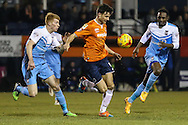 Jonathan Smith of Luton Town (centre) is chased down by Bradley Halliday of York City (left) and Marvin McCoy of York City (right) during the Sky Bet League 2 match at Kenilworth Road, Luton<br /> Picture by David Horn/Focus Images Ltd +44 7545 970036<br /> 10/02/2015