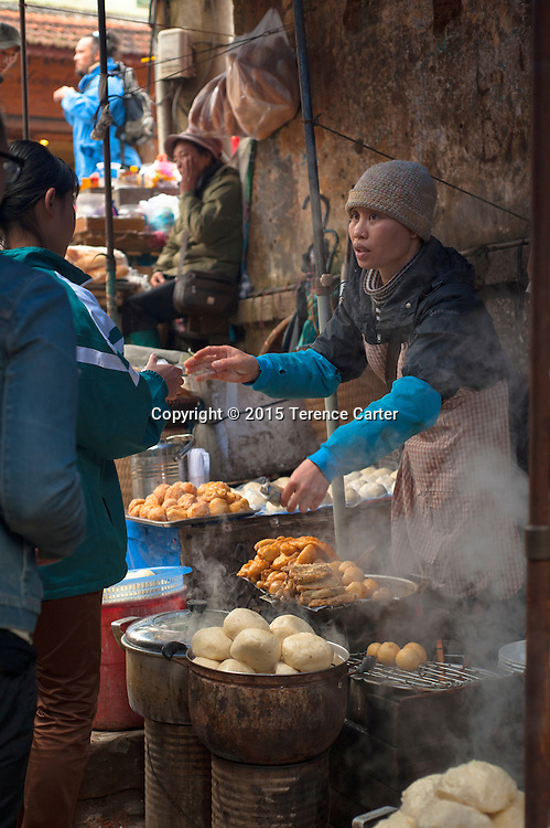 A vendor selling her food in the markets in Sapa, VIetnam.