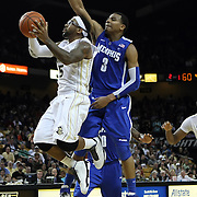 Central Florida guard Marcus Jordan (5) drives to the basket against Memphis guard Chris Crawford (3) during a Conference USA NCAA basketball game between the Memphis Tigers and the Central Florida Knights at the UCF Arena on February 9, 2011 in Orlando, Florida. Memphis won the game 63-62. (AP Photo: Alex Menendez)