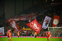 LIVERPOOL, ENGLAND - Wednesday, January 20, 2010: Liverpool supporters on the Spion Kop waves their flags and banners before the Premiership match against Tottenham Hotspur at Anfield. (Photo by: David Rawcliffe/Propaganda)
