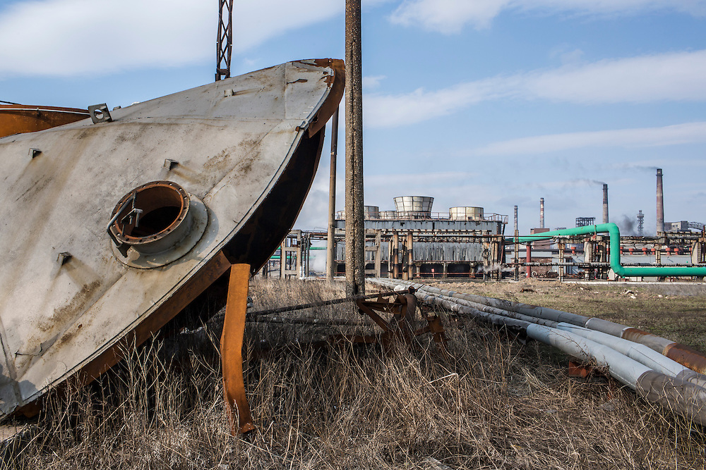 AVDIIVKA, UKRAINE - MARCH 18, 2015: The top of a benzene tank which blew off when the tank was hit by a rocket and exploded lies on the ground at the Avdiivka Coke and Steel plant in Avdiivka, Ukraine. CREDIT: Brendan Hoffman for The New York Times