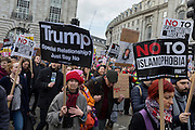 Young Muslim women protest at the Stop Trump's Muslim ban demonstration on 4th February 2017 in London, United Kingdom. The protest was called on by Stop the War Coalition, Stand Up to Racism, Muslim Association of Britain, Muslim Engagement and Development, the Muslim Council of Britain, CND and Friends of Al-Aqsa. Thousands of demonstrators gathered to demonstrate against Trump's ban on Muslims, saying it must be opposed by all who are against racism and support basic human rights, and for Theresa May not to collude with him.