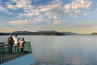 Ferry passengers admiring the view of the San Juan Islands Washington USA