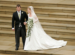 Peter Phillips and Canadian Autumn Kelly leave St. George's Chapel in Windsor after their marriage ceremony. Sang Tan/Anwar Hussein Collection/PA Photos