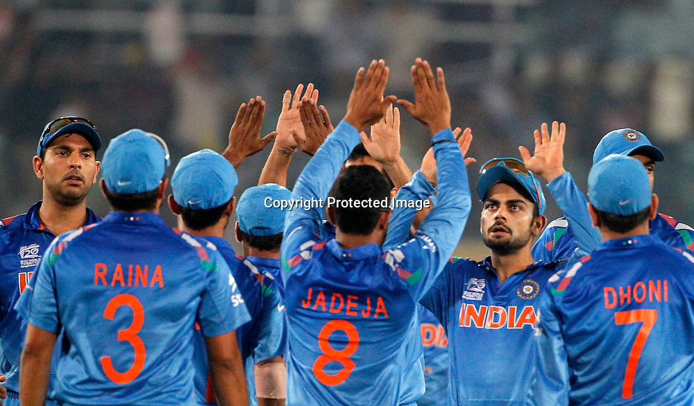 India celebrate a wicket, ICC T20 cricket World Cup Final - Sri Lanka v India, Sher-e-Bangla National Cricket Stadium, Mirpur, Bangladesh, 6 April 2014. Photo: www.photosport.co.nz