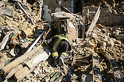 A firefighter searching for a dispersed person in Casale. A 6,4 earthquake has hit central Italy during the night between the 23 and 24 August killing more than 100. The town of Amatrice is been heavily damaged.