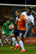 Jake Howells of Luton Town and Kelvin Etuhu of Bury during the The FA Cup match at Kenilworth Road, Luton<br /> Picture by David Horn/Focus Images Ltd +44 7545 970036<br /> 16/12/2014