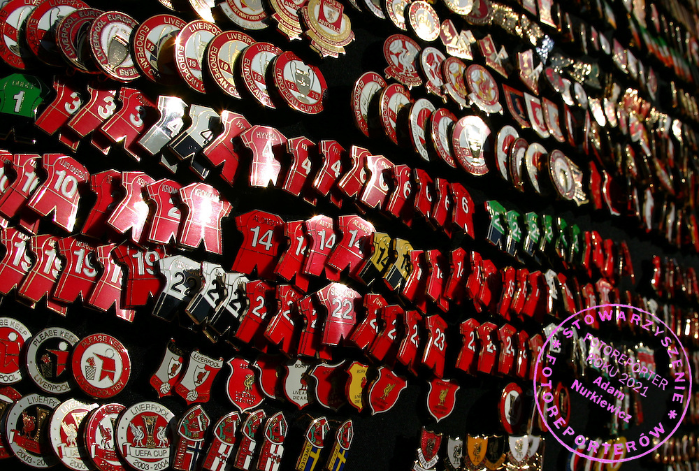 Badges for sale outside Anfield Stadium, home of Liverpool football club