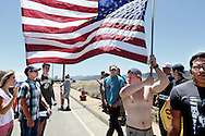MURRIETA, CA-JULY 7:  Anti-immigration activists protest outside of the U.S. Border Patrol Murrieta  Station in Murrieta, California on Monday, July 7, 2014. Immigration Protesters have staged rallies in front of the station for about a week in response to a wave of Illegal Immigrant children caught along the U.S. Mexico Border in Texas and are supposed to be temporarily housed at the facility while awaiting deportation proceedings.(Photo by Sandy Huffaker/Getty Images