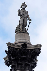 © Licensed to London News Pictures. 18/04/2016. Greenpeace environmental activists have scaled the 52m high Nelson's Column in Trafalgar Square to protest about the levels of air pollution in London. London, UK. Photo credit: Ray Tang/LNP