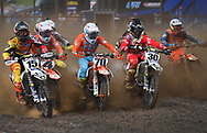 Mark DiOrio / Special to the Observer-Dispatch<br /> Riders in the 450MX division make a muddy start during the Lucas Oil AMA Pro Motocross Championship Aug. 12, 2017 at Unadilla Motocross in New Berlin, N.Y.