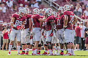 PALO ALTO, CA -  SEPTEMBER 13:  Quarterback Kevin Hogan #8 of the Stanford Cardinal calls a play in the huddle during an NCAA football game against the Army Black Knights played on September 13, 2014 at Stanford Stadium on the campus of Stanford University in Palo Alto, California.  Also visible are Devon Cajuste #89, Ty Montgomery #7, and Joshua Garnett #51. (Photo by David Madison/Getty Images) *** Local Caption *** Devon Cajuste;Kevin Hogan;Ty Montgomery;Joshua Garnett