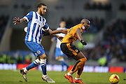 Wolverhampton Wanderers striker Benik Afobe (10) and Brighton central defender, Connor Goldson (17) during the Sky Bet Championship match between Brighton and Hove Albion and Wolverhampton Wanderers at the American Express Community Stadium, Brighton and Hove, England on 1 January 2016.