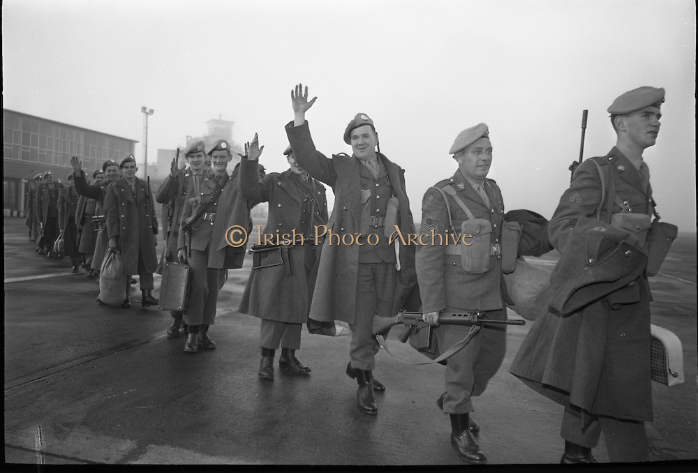Southern Command Troops boarding the U.S. Globemasters at Dublin Airport at dawn en route to Cyprus..13.10.1964