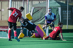 Southgate's Mickey Franklin shoots from close range following up a Rick Gay drag flick. Southgate v Old Loughtonians, Trent Park, London, UK on 15 March 2014. Photo: Simon Parker