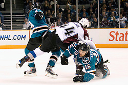 April 16, 2010; San Jose, CA, USA; Colorado Avalanche defenseman Ryan Wilson (center) fights for position with San Jose Sharks defenseman Rob Blake (4) and right wing Devin Setoguchi (16) during the first period of game two in the first round of the 2010 Stanley Cup Playoffs at HP Pavilion.  The Sharks defeated the Avalanche 6-5 in overtime. Mandatory Credit: Jason O. Watson / US PRESSWIRE
