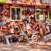 WHITE, GEORGIA, USA - JULY 26, 2014: One wall of the main garage building at the Old Car City junkyard in Georgia is covered with signs and spare auto parts in a colorful display of junk.