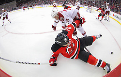 Mar 27, 2014; Newark, NJ, USA; Phoenix Coyotes center Jeff Halpern (14) trips up New Jersey Devils left wing Ryane Clowe (29) while battling for the puck during the first period at Prudential Center.