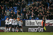 Bolton Wanderers' players celebrate scoring the winning goal in front of their fans. 2-1 in injury time during the EFL Sky Bet League 1 match between Bolton Wanderers and Scunthorpe United at the Macron Stadium, Bolton, England on 31 December 2016. Photo by Mark P Doherty.