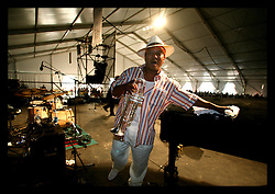 April 30th, 2006. New Orleans, Louisiana. Jazzfest . The New Orleans Jazz and Heritage festival. Legendary local jazz trumpeter Kermit Ruffins of the band Kermit REuffins and the Barbecue Swingers plays at the Bellsouth WWOZ Jazz tent.