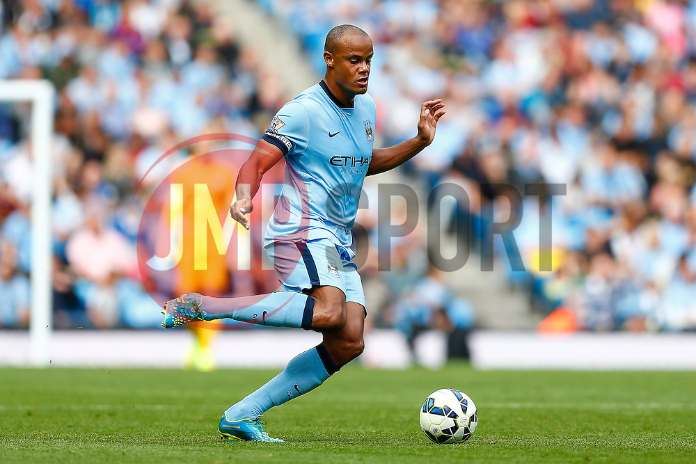 Vincent Kompany of Manchester City in action - Photo mandatory by-line: Rogan Thomson/JMP - 07966 386802 - 30/08/2014 - SPORT - FOOTBALL - Manchester, England - Etihad Stadium - Manchester City v Stoke City - Barclays Premier League.
