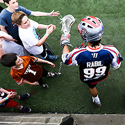 Paul Rabil #99 of the Boston Cannons greets young fans as he runs onto the field prior to the game at Harvard Stadium on May 10, 2014 in Boston, Massachusetts. (Photo by Elan Kawesch)