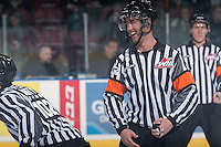 KELOWNA, CANADA - DECEMBER 30: Nick Swaine, referee stands at centre ice between the Kelowna Rockets and the Prince George Cougars on December 30, 2014 at Prospera Place in Kelowna, British Columbia, Canada.  (Photo by Marissa Baecker/Shoot the Breeze)  *** Local Caption *** Nick Swaine;