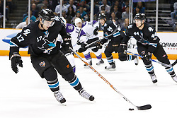 November 15, 2010; San Jose, CA, USA;  San Jose Sharks center Torrey Mitchell (17) skates with the puck against the Los Angeles Kings during the first period at HP Pavilion. Mandatory Credit: Jason O. Watson / US PRESSWIRE