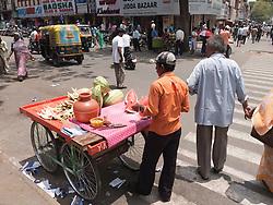 Street vendor of melon in Mysore.