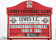 Visitors next game signage before the FA Women's Championship match between Lewes Women FC and Manchester United Women FC at the Dripping Pan, Lewes, East Sussex, United Kingdom on 2 December 2018.