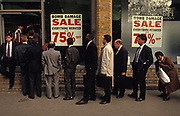 Days after the Irish Republican Army (IRA) exploded a truck bomb on Bishopsgate, a main arterial road that travels north-south through London's financial area, City of London, bomb damaged stock goes on sale at reduced prices in a branch of menswear outfitters, Moss Bross at Liverpool Street Station. on 26th April 1993, in London, England. One person was killed when the one ton fertiliser bomb detonated directly outside the medieval St Ethelburga's church. Buildings up to 500 metres away were damaged, with one and a half million square feet (140,000 m²) of office space being affected and over 500 tonnes of glass broken. Costs of repairing the damage was estimated at £350 million. It was possibly the (IRA's) most successful military tactic since the start of the Troubles.