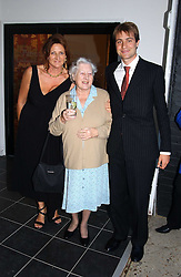 Left to right, KATHRYN IRELAND, MIMI the Goldsmith family nanny and BEN GOLDSMITH at a party hosted by Kathryn Ireland held at her showroom at 65-69 Lots Road, London on 27th September 2005.<br />