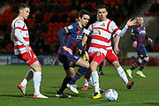 Bradford City midfielder Alex Gilliead and Doncaster Rovers defender Mathieu Baudry challenge for the ball during the EFL Sky Bet League 1 match between Doncaster Rovers and Bradford City at the Keepmoat Stadium, Doncaster, England on 19 March 2018. Picture by Aaron  Lupton.