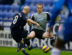 WIGAN, ENGLAND - Sunday, January 20, 2008: Everton's Andy Johnson scores the opening goal against Wigan Athletic's goalkeeper Chris Kirkland during the Premiership match at the JJB Stadium. (Photo by David Rawcliffe/Propaganda)