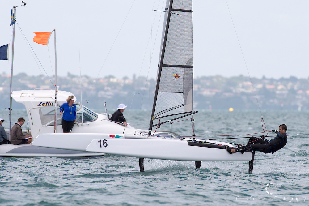 Blair Tuke (NZL265) finishes race three in third. A Class World championships regatta being sailed at Takapuna in Auckland. 12/2/2014
