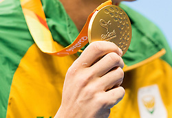 Winner Kevin Paul of South Africa Republic celebrates at medal ceremony after the Men's 100m Breaststroke SB9 Final on day 1 during the Rio 2016 Summer Paralympics Games on September 8, 2016 in Olympic Aquatics Stadium, Rio de Janeiro, Brazil. Photo by Vid Ponikvar / Sportida