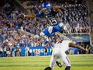 Kentucky Wildcats quarterback Stephen Johnson (15) leaps over Missouri Tigers safety Thomas Wilson (8) for a 7 yard gain during the game at Kroger Field on the campus of The University of Kentucky in Lexington, Ky, Saturday, October 7, 2017.